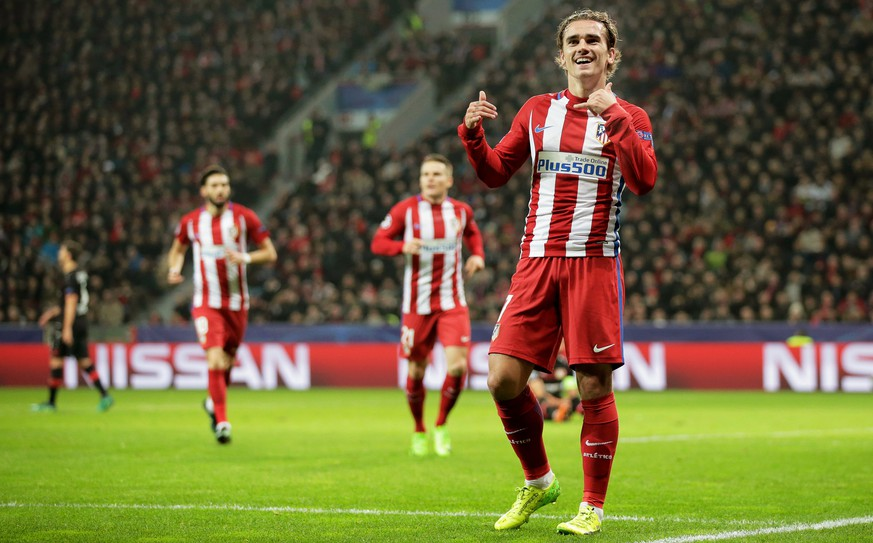 epa05807410 Atletico Madrid's Antoine Griezmann celebrates after scoring the 2-0 lead during the UEFA Champions League Round of 16, first leg soccer match between Bayer Leverkusen and Atletico Madrid in Leverkusen, Germany, 21 February 2017.  EPA/FRIEDEMANN VOGEL