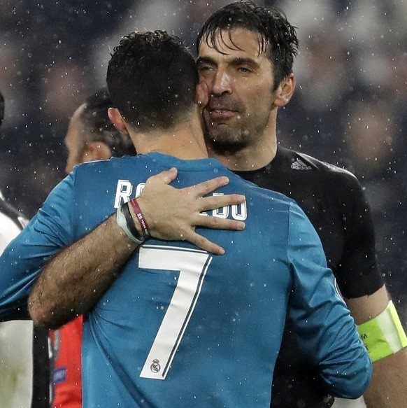 Juventus goalkeeper Gianluigi Buffon, right, hugs Real Madrid's Cristiano Ronaldo after the Champions League, round of 8, first-leg soccer match between Juventus and Real Madrid at the Allianz stadium in Turin, Italy, Tuesday, April 3, 2018. Real won 3-0. (AP Photo/Luca Bruno)
