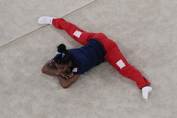 Simone Biles, of the United States, warms up before the women's balance beam finals at the 2020 Summer Olympics, Tuesday, Aug. 3, 2021, in Tokyo, Japan. (AP Photo/Morry Gash)