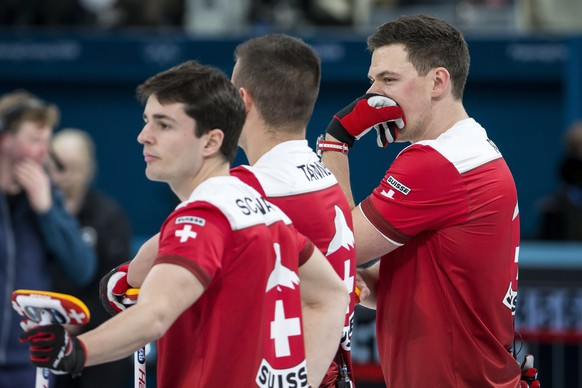 Benoit Schwarz, Valentin Tanner and Claudio Paetz of Switzerland, from left, during the Curling round robin game of the men between Switzerland and Italy at the XXIII Winter Olympics 2018 in Gangneung, South Korea, on Wednesday, February 14, 2018. (KEYSTONE/Alexandra Wey)