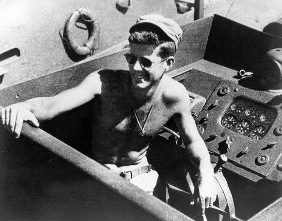 epa03949112 (89/89) (FILE) A file picture shows John F. Kennedy aboard the PT-109 in the South Pacific, in 1943. 22 November 2013 marks the 50th anniversary of John F. Kennedy assassination on 22 November 1963 at Dealey Plaza in Dallas, Texas, USA. Lee Harvey Oswald was accused of the shooting and was later killed himself on 24 November 1963 by a gunshot by Jack Ruby.  EPA/John F. Kennedy Presidential Library and Museum, Boston EDITORIAL USE ONLY/NO SALES