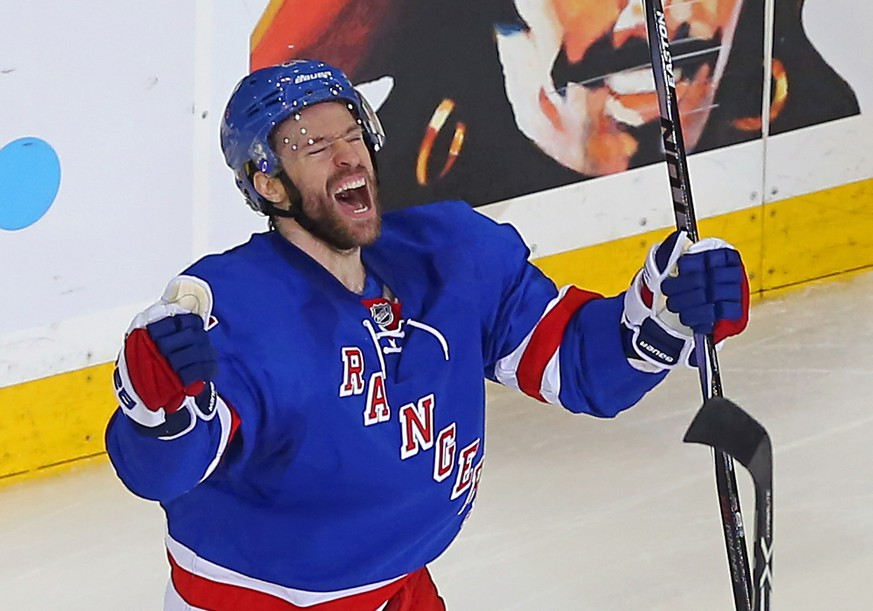 May 16, 2015; New York, NY, USA; New York Rangers center Dominic Moore (28) celebrates after scoring the game-winning goal to defeat the Tampa Bay Lightning 2-1 in game one of the Eastern Conference Final of the 2015 Stanley Cup Playoffs at Madison Square Garden. Mandatory Credit: Adam Hunger-USA TODAY Sports