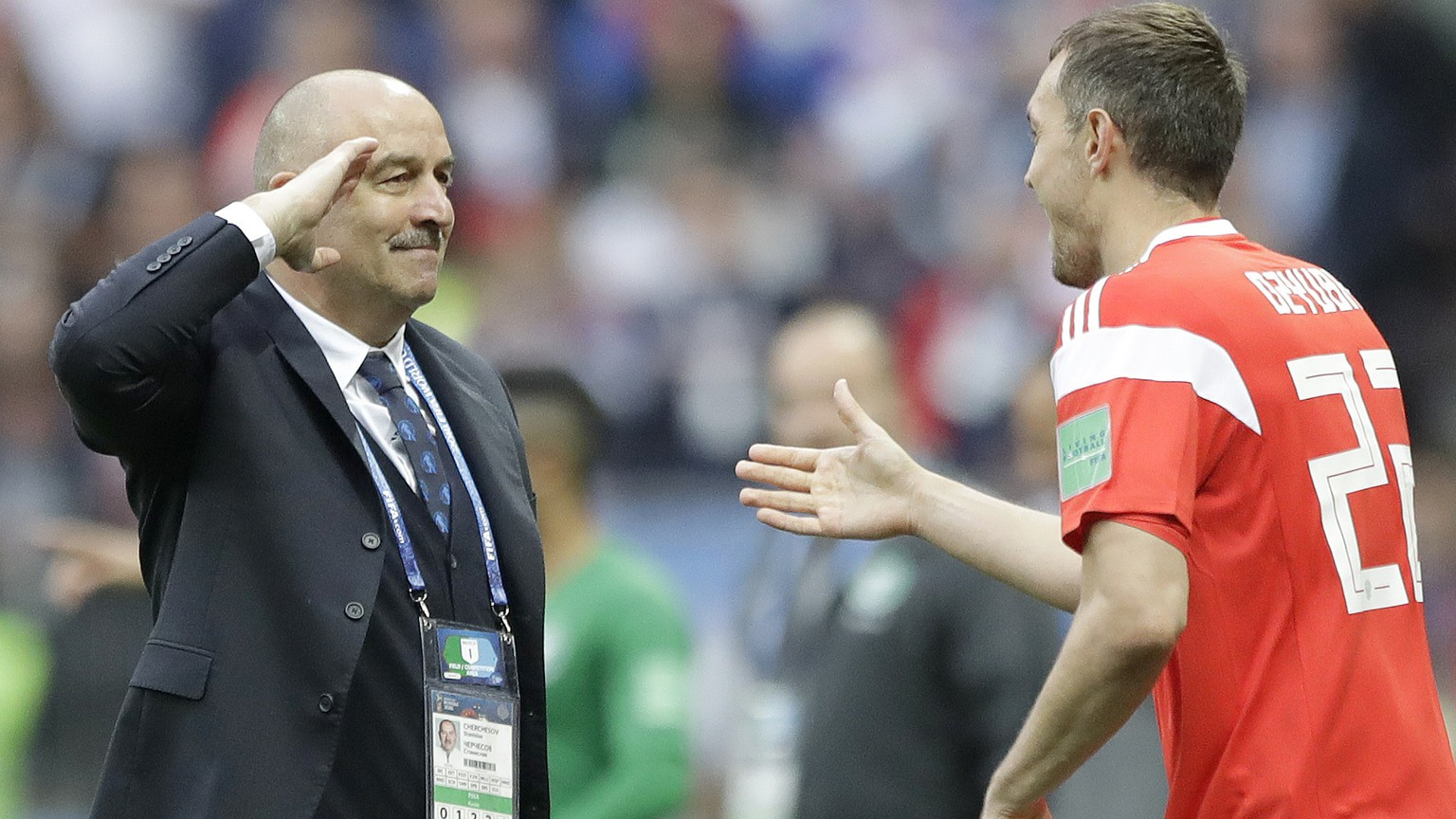 Russia head coach Stanislav Cherchesov, left, salutes to goal scorer Russia's Artyom Dzyuba during the group A match between Russia and Saudi Arabia which opens the 2018 soccer World Cup at the Luzhniki stadium in Moscow, Russia, Thursday, June 14, 2018. (AP Photo/Matthias Schrader)