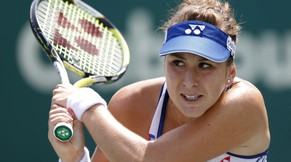 Belinda Bencic, from Switzerland, returns to Casey Dellacqua during a match at the Family Circle Cup tennis tournament in Charleston, S.C., Tuesday, April 7, 2015. Bencic won 6-1, 6-2.  (AP Photo/Mic Smith)