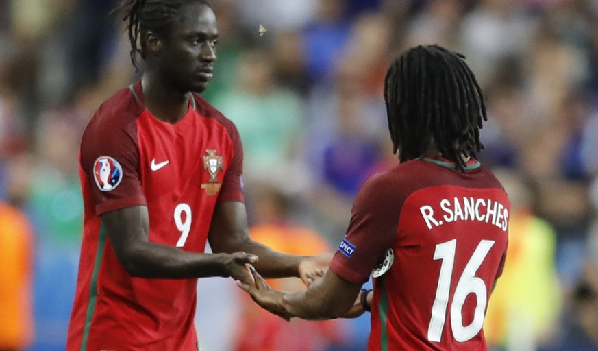 Portugal's Eder, left, replaces Renato Sanches during the Euro 2016 final soccer match between Portugal and France at the Stade de France in Saint-Denis, north of Paris, Sunday, July 10, 2016. (AP Photo/Frank Augstein)