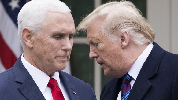 epa08931300 (FILE) - US President Donald J. Trump (R) turns over the podium to US Vice President Mike Pence (L) during a news conference in the Rose Garden of the White House in Washington, DC, USA, 04 January 2019 (reissued 11 January 2021). According to reports on 11 January 2021, US House Speaker Nancy Pelosi urged US Vice President Mike Pence to oust US President Trump by invoking the 25th amendment, or said the Democrats would move forward with an impeachment.  EPA/MICHAEL REYNOLDS *** Local Caption *** 54874631