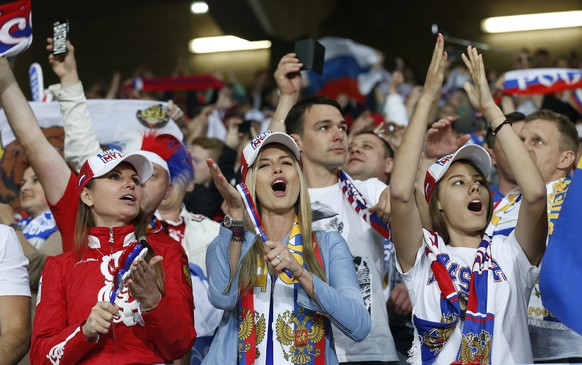 epa05366658 Russia supporters before the UEFA EURO 2016 group B preliminary round match between Russia and Slovakia at Stade Pierre Mauroy in Lille, France, 15 June 2016.  (RESTRICTIONS APPLY: For editorial news reporting purposes only. Not used for commercial or marketing purposes without prior written approval of UEFA. Images must appear as still images and must not emulate match action video footage. Photographs published in online publications (whether via the Internet or otherwise) shall have an interval of at least 20 seconds between the posting.)  EPA/LAURENT DUBRULE   EDITORIAL USE ONLY