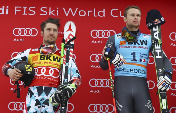 Austria's Marcel Hirscher, left, second placed, and France's Alexis Pinturault, the winner, celebrate on podium after an alpine ski, men's World Cup giant slalom in Adelboden, Switzerland, Saturday, Jan. 7, 2017. (AP Photo/Alessandro Trovati)