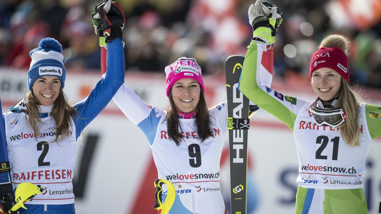 Winner Wendy Holdener of Switzerland, center, poses with second placed Marta Bassino of Italy, left, and third placed Ana Bucik of Slovenia, right, during the podium ceremony after the Slalom run of the women's Alpine Combined race at the Alpine Skiing FIS Ski World Cup in Lenzerheide, Switzerland, Friday, January 26, 2018. (KEYSTONE/Jean-Christophe Bott)