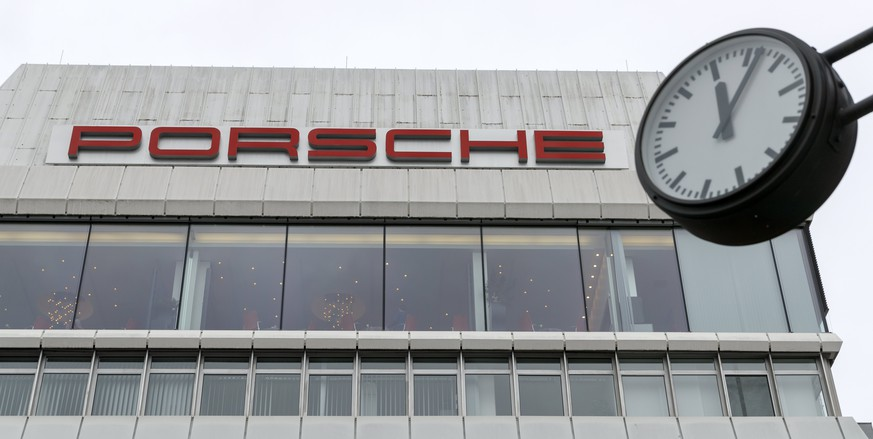 epa06681207 (FILE) - A clock indicating 6 minutes past 12 o'clock hangs in front of the sports car manufacturer Porsche in Stuttgart, Germany, 26 January 2018 (re-issued 20 April 2018). German media 20 April 2018 report Baden-Wuerttemberg state prosecutors have arrested a Porsche manager as part of investigations to the diesel emissions scandal. Authorities are investigating two current and two former Porsche employees as part of investigations to alleged fraud and illegal advertising involving Porsche staff.  EPA/RONALD WITTEK