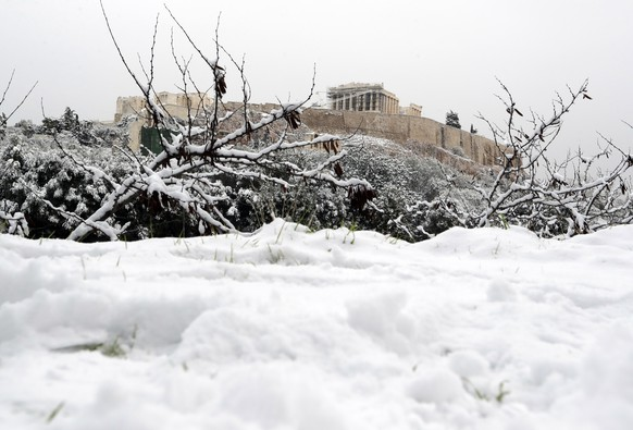 The Parthenon temple is seen atop of the snow-covered Acropolis hill in Athens, on Tuesday, Jan. 10, 2017. Swathes of Greece have been covered by snow, including several islands, some of which have seen more than a meter (more than three feet) of snow. (AP Photo/Thanassis Stavrakis)