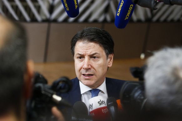 epa08234009 Italian Premier Antonio Contes speaks to media as he arrives at the second day of a Special European Council summit in Brussels, Belgium, 21 February 2020. EU heads of state or government gather for a special meeting to discuss the EU's long-term budget for 2021-2027.  EPA/JULIEN WARNAND
