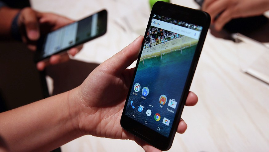 SAN FRANCISCO, CA - SEPTEMBER 29:  An attendee inspects the new Nexus 5X phone during a Google media event on September 29, 2015 in San Francisco, California. Google unveiled its 2015 smartphone lineup, the Nexus 5x and Nexus 6P, the new Chromecast and new Android 6.0 Marshmallow software features.  (Photo by Justin Sullivan/Getty Images)