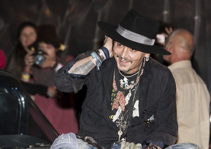 Actor Johnny Depp arrives at the Glastonbury music festival at Worthy Farm, in Somerset, England, Thursday, June 22, 2017. (Photo by Grant Pollard/Invision/AP)