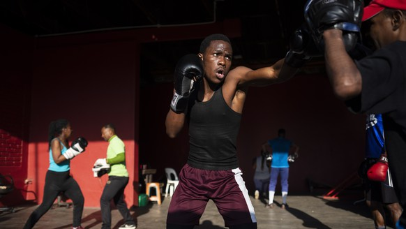 epaselect epa08628843 Boxers spar at a gym in the early morning after the national sports minister allowed boxing to re-start after 153 days of lockdown due to the Covid-19 coronavirus, in Johannesburg, South Africa, 27 August 2020. The country has moved to lockdown level 2 and has slowly started to allow various sporting codes to resume. The gym is situated in one of the country's most dangerous inner city areas and is built in a dis-used petrol station. Both male and female boxers from all races train with George Khosi. Khosi was once The Soweto Super Middle weight boxing champion until one day in 1997 robbers shot him in both legs and in the right eye, ending his boxing career.  EPA/KIM LUDBROOK