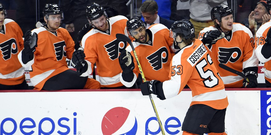 Jan 5, 2016; Philadelphia, PA, USA; Philadelphia Flyers defenseman Shayne Gostisbehere (53) celebrates his goal with teammates against the Montreal Canadiens during the second period at Wells Fargo Center. Mandatory Credit: Eric Hartline-USA TODAY Sports