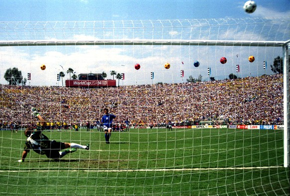 Italy's Roberto Baggio puts his penalty over the bar in the World Cup final against Brazil at the Rose Bowl in Pasadena, California July 17, 1994. Derided as a lottery by critics, the penalty shootout is unsurpassed as the ultimate test of nerve to decide tied games. The split-second moment can make a player a hero, or forever scar an otherwise unblemished career. Picture taken July 17, 1994. To match Feature SOCCER-WORLD/PENALTIES       REUTERS/Gary Hershorn (UNITED STATES - Tags: SPORT SOCCER WORLD CUP) - RTR2EEMB