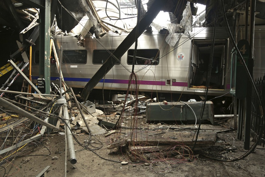 FILE - This Oct. 1, 2016, file photo, provided by the National Transportation Safety Board shows damage done to the Hoboken Terminal in Hoboken, N.J., after a commuter train crash. New Jersey Transit is implementing a new rule after the crash. NJ Transit spokeswoman Jennifer Nelson said the conductor must join the engineer whenever a train pulls into Hoboken Terminal or Atlantic City. That means a second set of eyes will be watching as a train enters the final phase of its trip at stations where there are platforms at the end of the rails. (Chris O'Neil/NTSB photo via AP, File)