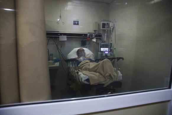 A COVID-19 patient lies on a bed of the Mexico City Ajusco Medio General Hospital ICU ward, Wednesday, Dec. 2. 2020. Mexico continues to report an increase in the number of coronavirus cases, with Mexico City continuing to report the biggest portion of the surge. (AP Photo/Marco Ugarte)