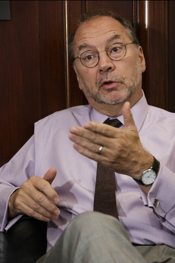 Dr. Peter Piot, the co-discoverer of the Ebola virus, speaks during an interview with The Associated Press at his office at the London School of Hygiene and Tropical Medicine in London, Friday, Oct. 17, 2014. Piot questioned why it took the World Health Organization five months and 1,000 deaths before the agency declared Ebola an international health emergency in August. (AP Photo/David Azia)