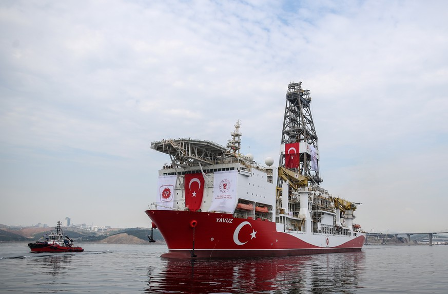 epa07660390 The Turkish drilling vessel Yavuz leaves from  Dilovasi port in city of Kocaeli, Turkey, 20 June 2019. Turkey's second drilling ship will operate off the Karpas Peninsula to the northeast of the island of Cyprus. Yavuz will be determined by geology and geophysics studies of the vessel and it will take place at a depth of approximately 1,000 meters on the seabed and some 3,000 meters of drilling will be made, Bilgin said, adding that the ship will move to its second location once the first drill is completed.  EPA/ERDEM SAHIN