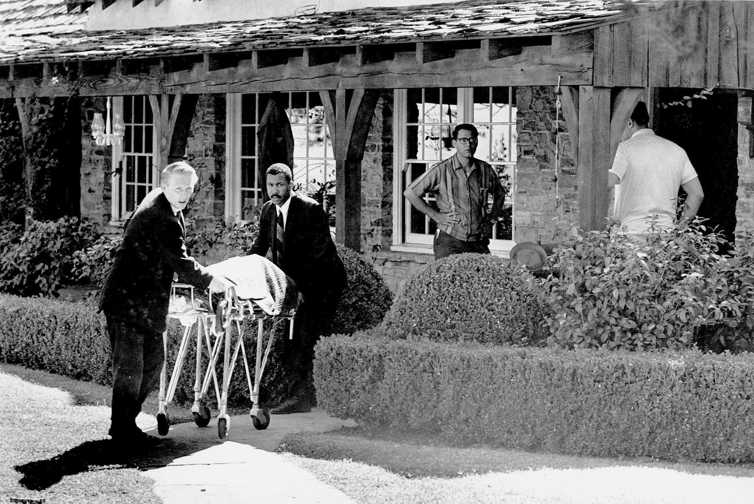 FILE - This Aug. 9, 1969 file photo shows the body of actress Sharon Tate being taken from her rented house on Cielo Drive in the Bel Air Estates area of Los Angeles. Cult leader Charles Manson, who directed his
