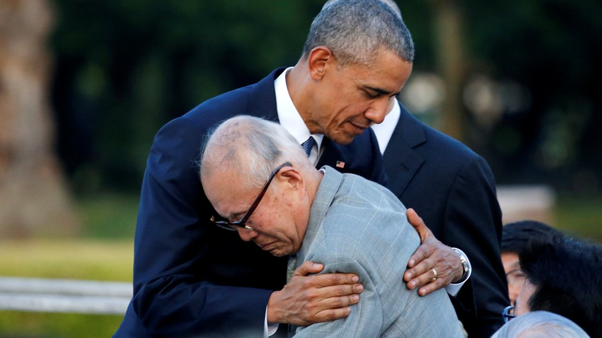 U.S. President Barack Obama (L) hugs with atomic bomb survivor Shigeaki Mori as he visits Hiroshima Peace Memorial Park in Hiroshima, Japan May 27, 2016. REUTERS/Carlos Barria