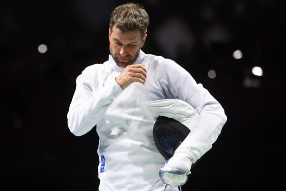 Switzerland's Benjamin Steffen looks desapointed after loosing against Ukraine's Igor Reizlin during the men's epee fencing individual round of 32 competition at the 2020 Tokyo Summer Olympics at the Makuhari Messe Hall in Chiba City, near Tokyo, Japan, on Sunday, July 25, 2021. (KEYSTONE/Laurent Gillieron)