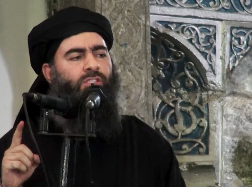 FILE - FILE - This file image made from video posted on a militant website Saturday, July 5, 2014, purports to show the leader of the Islamic State group, Abu Bakr al-Baghdadi, delivering a sermon at a mosque in Iraq during his first public appearance. (AP Photo/Militant video, File)