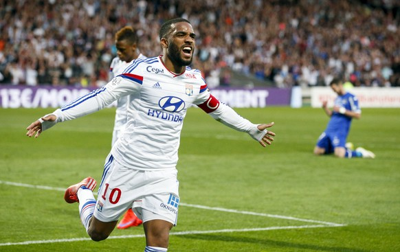 Olympique Lyon's Alexandre Lacazette celebrates after scoring against Bastia during their French Ligue 1 soccer match at the Gerland stadium in Lyon April 15, 2015.  REUTERS/Robert Pratta