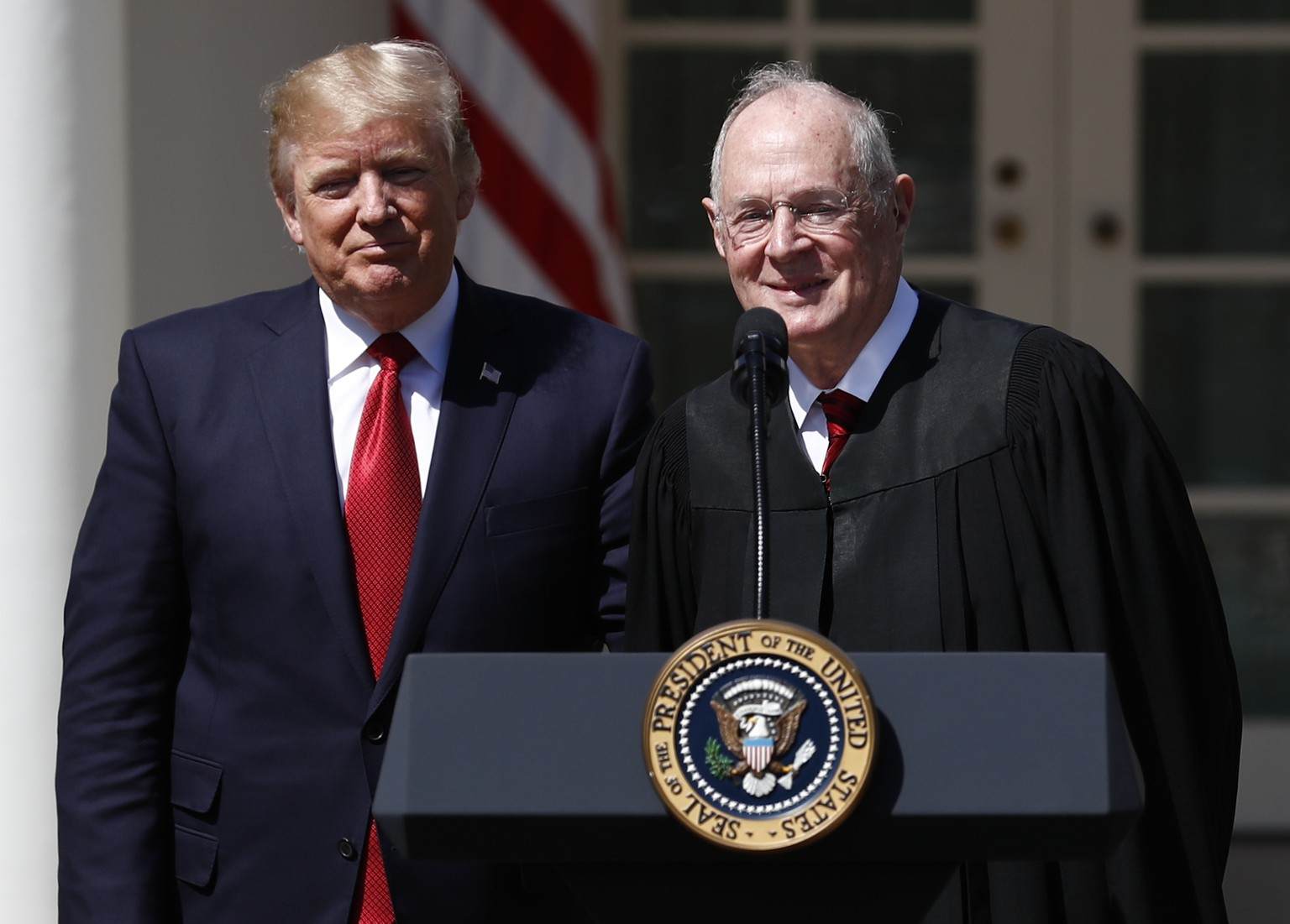 FILE - In this April 10, 2017, file photo, President Donald Trump, left, and Supreme Court Justice Anthony Kennedy participate in a public swearing-in ceremony for Justice Neil Gorsuch in the Rose Garden of the White House White House in Washington. As one justice settles into his new job at the Supreme Court, is another about to leave? Kennedy is so far refusing to comment on speculation that he may soon retire after 29 years on the court. But that hasn't stopped Trump and, obliquely, the Republican senator in charge of high court confirmation hearings from weighing in on the prospect that Kennedy could step down as soon as this spring or summer.  (AP Photo/Carolyn Kaster)