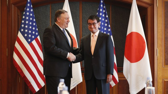 epa06805926 US Secretary of State Mike Pompeo (L) shakes hands with Japan's Foreign Minister Taro Kono (R) during a bilateral meeting at a hotel  in Seoul, South Korea, 14 June 2018. US Secretary of State Mike Pompeo is in South Korea to meet South Korea's President Moon Jae-in and to hold talks on the results of the US North Korea Summit in Singapore.  EPA/KIM HONG-JI / POOL