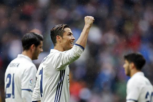 Real Madrid's Cristiano Ronaldo celebrates at the end of the Spanish La Liga soccer match between Real Madrid and Valencia at the Santiago Bernabeu stadium in Madrid, Saturday, April 29, 2017. Ronaldo scored once in the Real Madrid's 2-1 victory. (AP Photo/Francisco Seco)