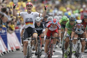 Germany's Andre Greipel, left, crosses the finish line ahead of second place Norway's Alexander Kristoff, center, third place Samuel Dumoulin of France, right, Australia's Mark Renshaw, second left and fourth place, and Peter Sagan of Slovakia, second right and fifth place, to win the sixth stage of the Tour de France cycling race over 194 kilometers (120.5 miles) with start in Arras and finish in Reims, France, Thursday, July 10, 2014. (AP Photo/Peter Dejong)