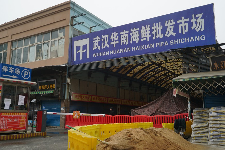 The Wuhan Huanan Wholesale Seafood Market, where a number of people related to the market fell ill with a virus, sits closed in Wuhan, China, Tuesday, Jan. 21, 2020. Heightened precautions were being taken in China and elsewhere Tuesday as governments strove to control the outbreak of the coronavirus, which threatens to grow during the Lunar New Year travel rush. (AP Photo/Dake Kang)