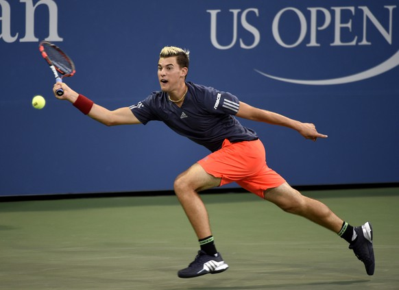 Dominic Thiem, of Austria, stretches to return the ball against Kevin Anderson, of South Africa, in the third round at the U.S. Open tennis tournament on Saturday, Sept. 5, 2015, in New York. Anderson won in three straight sets. (AP Photo/Kathy Kmonicek)