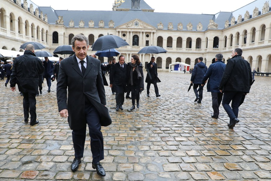 epa06634179 Former French President Nicolas Sarkozy (L) and former French President Francois Hollande (Rear C-L) leave following a national ceremony for Lieutenant-Colonel Arnaud Beltrame, at the Hotel des Invalides in Paris, France, 28 March 2018. France honours during a national ceremony on March 28 a heroic policeman who died offering himself as a hostage in a jihadist attack. Beltrame, 44, was the fourth and final victim in the shooting spree on March 23 in the southwestern towns of Carcassonne and nearby Trebes.  EPA/LUDOVIC MARIN / POOL MAXPPP OUT