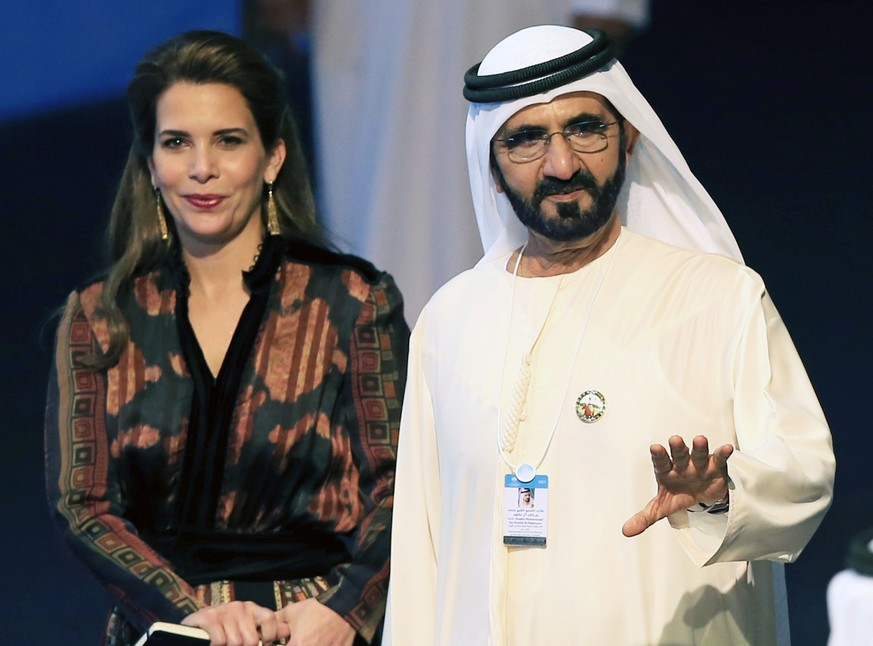 epa08272773 (FILE) - Sheikh Mohammed bin Rashid Al Maktoum (R), Vice President, Prime Minister of the UAE and Ruler of Dubai arrives with Princess Haya bint Al Hussein (L) during the World Government Summit 2017 at Madinat Jumeirah in Dubai, United Arab Emirates, 14 February 2017 (reissued 05 March 2020). According to media reports, Sheikh Mohammed bin Rashid Al Maktoum was found by a Britain court to have conducted a campaign of fear against his ex-wife and ordered the kidnap and torture of his two runaway daughters.  EPA/STR