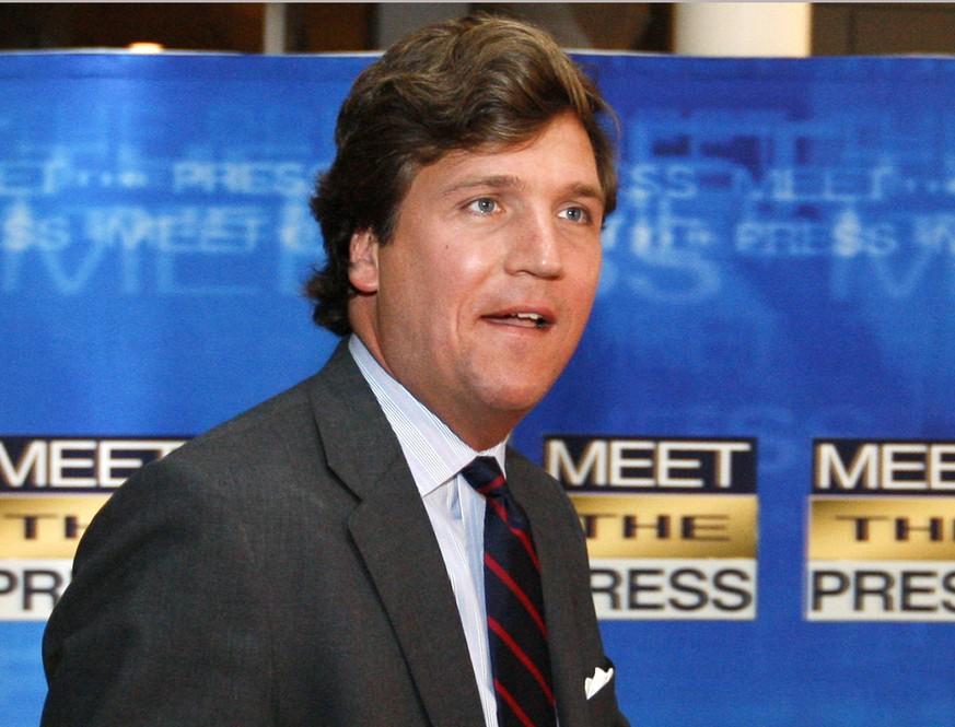 FILE - In this Nov. 17, 2007 file photo, political commentator Tucker Carlson arrives for the 60th anniversary celebration of NBC's Meet the Press at the Newseum in Washington. Fox News Channel says Tucker Carlson is claiming the weeknight host slot recently vacated by Greta Van Susteren. He will take over the 7 p.m. Eastern hour on Nov. 14, the network said  (AP Photo/Charles Dharapak, File)