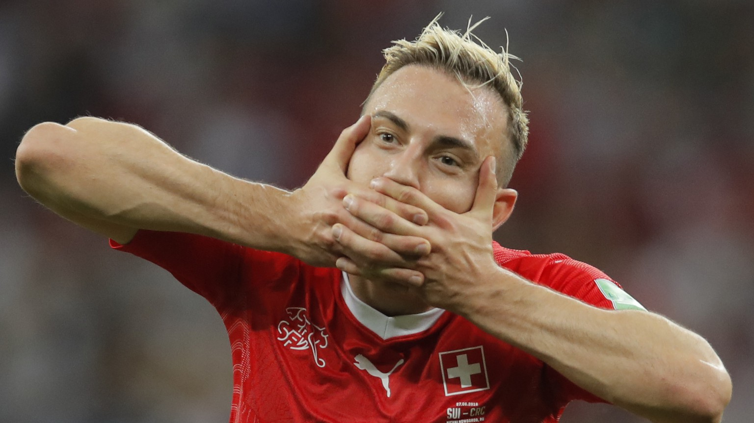 Switzerland's Josip Drmic celebrates after scoring his side's second goal during the group E match between Switzerland and Costa Rica at the 2018 soccer World Cup in the Nizhny Novgorod Stadium in Nizhny Novgorod , Russia, Wednesday, June 27, 2018. Drmic scored once and the match ended in a 2-2 draw. (AP Photo/Vadim Ghirda)