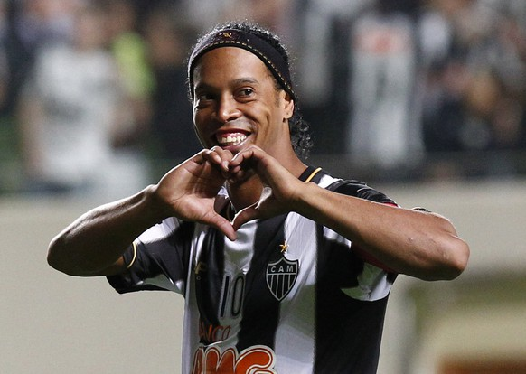 FILE - In this July 11, 2013 file photo, Brazil's Atletico Mineiro's Ronaldinho celebrates his team's victory over Argentina's Newell's Old Boys at the end of a Copa Libertadores semifinal soccer match in Belo Horizonte, Brazil. The Brazilian soccer midfielder is putting his Rio de Janeiro mansion on the rental market during the last half of the World Cup. The real estate agency handling the property says on its website that the five-bedroom house is available for the first 15 days of July for $15,522 a day. (AP Photo/Bruno Magalhaes, File)