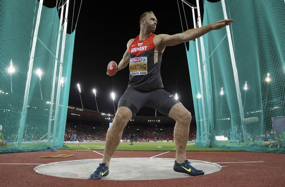 Robert Harting of Germany competes in the men's discus throw final during the European Athletics Championships at the Letzigrund Stadium in Zurich August 13, 2014.  REUTERS/Phil Noble (SWITZERLAND  - Tags: SPORT ATHLETICS)