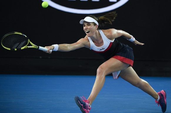Britain's Johanna Konta makes a forehand return to Spain's Garbine Muguruza during their second round match at the Australian Open tennis championships in Melbourne, Australia, Friday, Jan. 18, 2019. (AP Photo/Andy Brownbill)