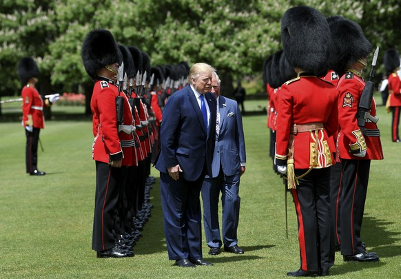 U.S President Donald Trump inspects an honour guard with Britain's Prince Charles during a welcome ceremony in the garden of Buckingham Palace, in London, Monday, June 3, 2019, on the first day of a three day state visit to Britain. (Toby Melville/Pool via AP)