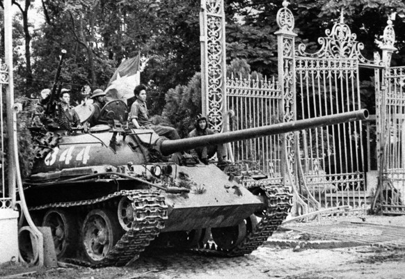 In this April 30, 1975 photo, a North Vietnamese tank rolls through the gate of the Presidential Palace in Saigon, signifying the fall of South Vietnam. Vietnam will celebrate its 34th anniversary of the end of the Vietnam War on April 30, 2009.  (AP Photo)