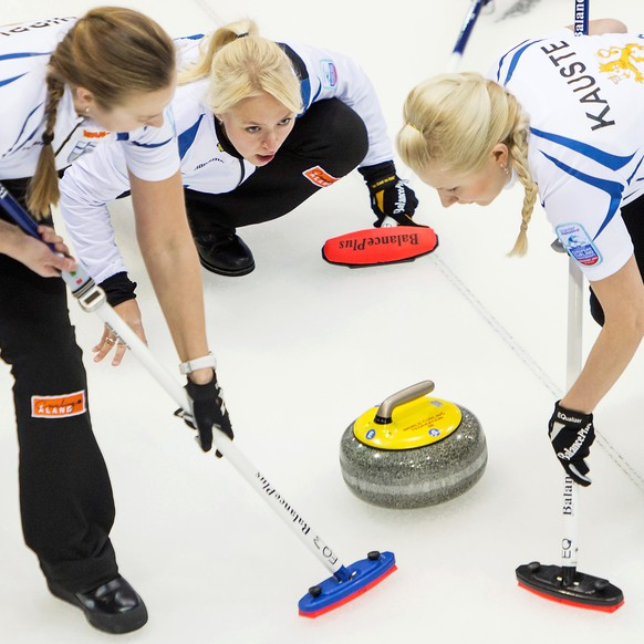 Skip Sanna Puustinen of Finland, center, plays a stone with team mates against Germany during the women's qualification round match of the European Curling Championships 2014, at the Palladium Ice Arena, in Champery, Switzerland, Wednesday, November 26, 2014. (KEYSTONE/Jean-Christophe Bott)