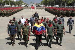 Venezuela's President Nicolas Maduro (C) attends a military parade to commemorate the 23th anniversary of late president Hugo Chavez failed coup attempt in Caracas in this February 4, 2015 picture provided by Miraflores Palace. REUTERS/Miraflores Palace/Handout via Reuters (VENEZUELA - Tags: POLITICS MILITARY ANNIVERSARY)