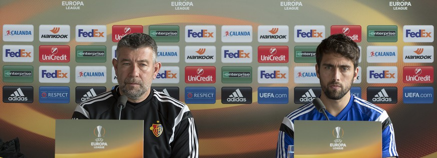 Urs Fischer, head coach of Switzerland's soccer team FC Basel, left, and captain Matias Delgado, right, during a press conference in the St. Jakob-Park stadium in Basel, Switzerland, on Wednesday, February 24, 2016. Switzerland's FC Basel 1893 is scheduled to play against France's AS Saint-Etienne in an UEFA Europa League Round of 32 second leg soccer match on Thursday, February 25, 2016. (KEYSTONE/Georgios Kefalas)