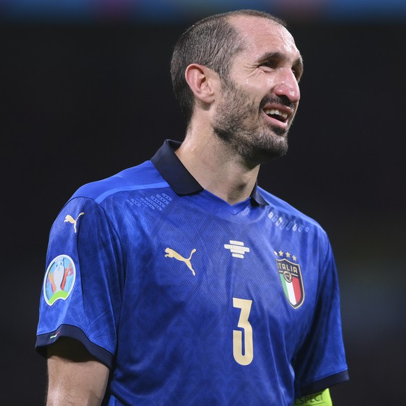 Italy's Giorgio Chiellini reacts during the Euro 2020 soccer semifinal match between Italy and Spain at Wembley stadium in London, Tuesday, July 6, 2021. (Laurence Griffiths, Pool via AP)