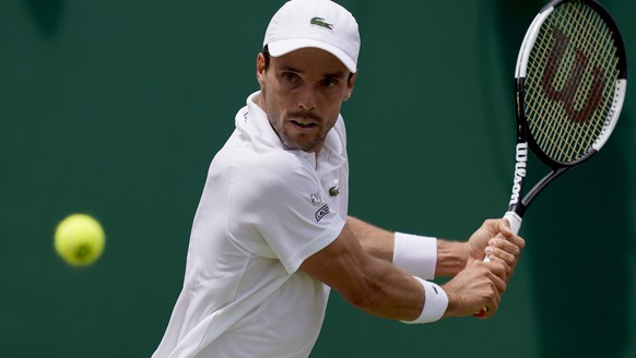 epa07697282 Roberto Bautista Agut of Spain in action against Karen Khachanov of Russia during their third round match at the Wimbledon Championships at the All England Lawn Tennis Club, in London, Britain, 05 July 2019. EPA/WILL OLIVER EDITORIAL USE ONLY/NO COMMERCIAL SALES